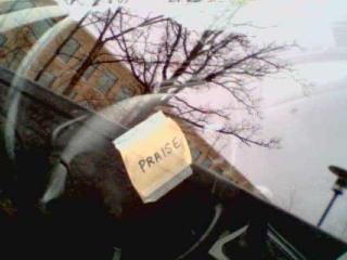 A Post-It note with 'praise' - does someone have anger management issues?
