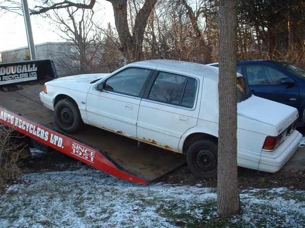 Here is our Dodge Spirit getting hauled away to Car Heaven