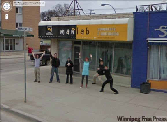 Co-workers from ManLab in Winnipeg, MB ham it up for the Google Street View car.