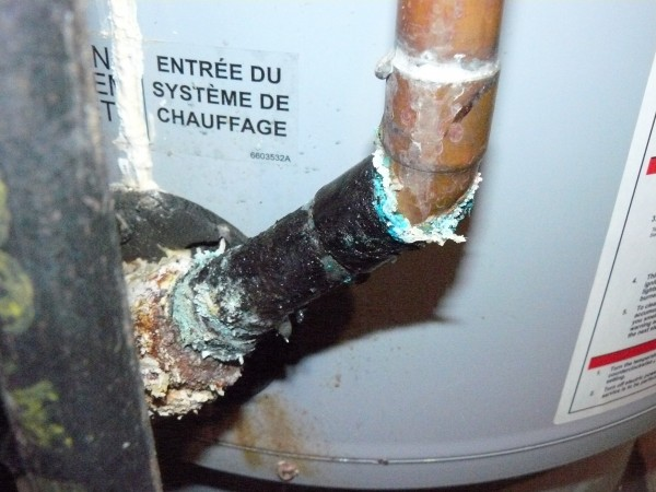 One of the fittings on the old Polaris water heater that was badly corroded and leaking. This one is also immediately above the natural gas inlet.