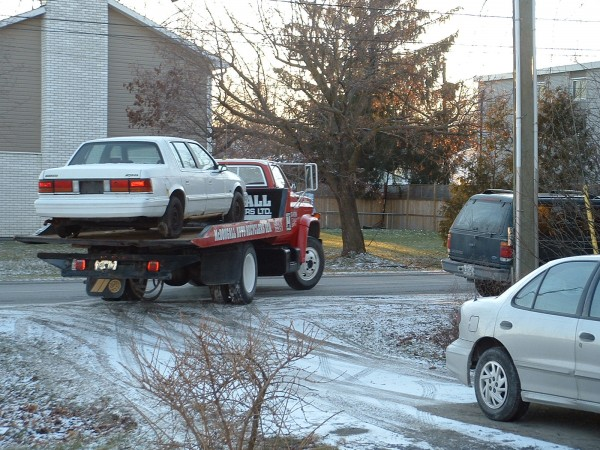 There goes the old Dodge Spirit to Car Heaven
